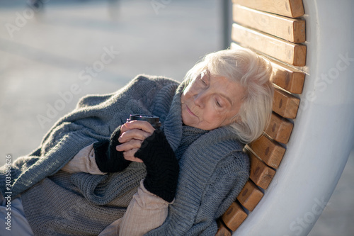 Vászonkép  Woman drinking tea while spending day outside
