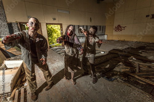 Zombies attack in an abandoned dark building Wallpaper Mural