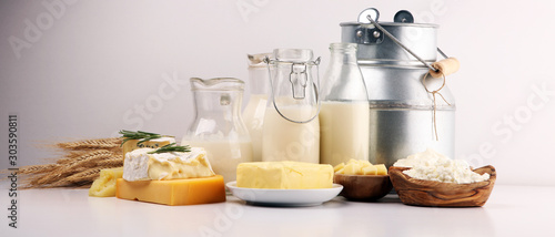 Cuadros en Lienzo Different  healthy dairy products on rustic background with milk, cheese, butter