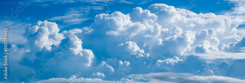 View of thick white cloud and blue sky pictures background and texture - 303594662