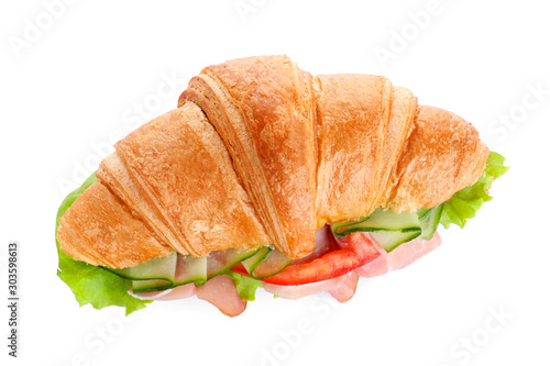 Fototapeta  Tasty croissant sandwich with ham and tomato isolated on white, top view
