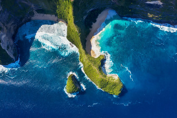 Aerial view at sea and rocks. Azure water background from top view. Kelingking beach, Nusa Penida, Bali, Indonesia. Travel Asia - image