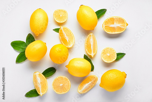 Ripe lemons on white background - 303606051