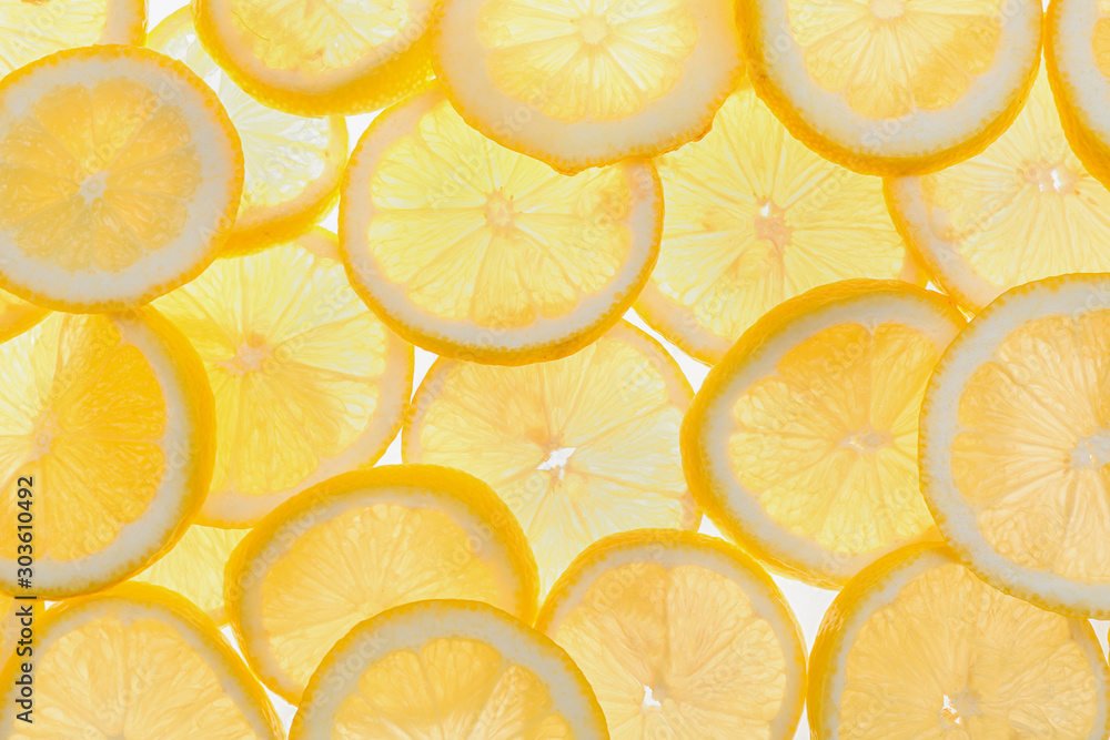Fototapety, obrazy: Slices of fresh lemon as background, top view