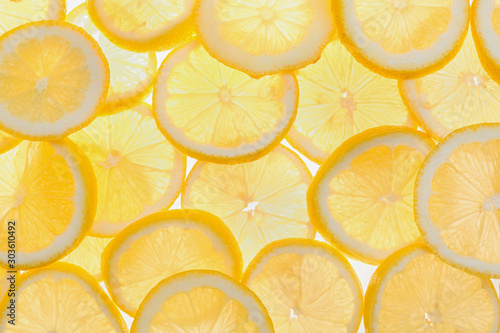 Slices of fresh lemon as background, top view