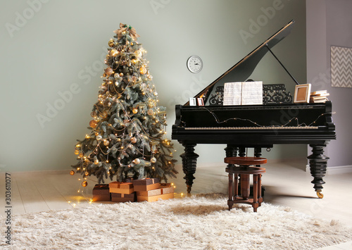 Grand piano in room decorated for Christmas Fototapeta