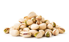 Pile Of Pistachios In The Peel Close-up On A White Background. Isolated.