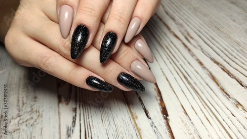 stylish design of manicure on beautiful nails Fototapeta