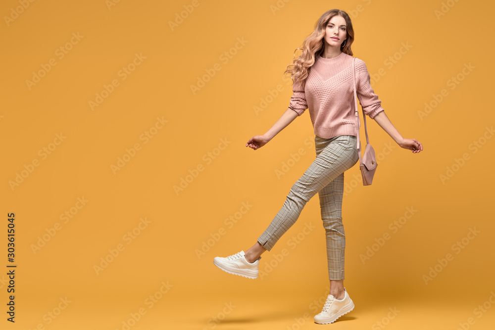 Fototapeta Fashionable woman with stylish hairstyle, makeup dance. Carefree happy blonde girl having fun, trendy pink outfit, fashion hair. Sensual female model, dancing happiness concept