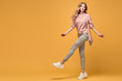 Fashionable woman with stylish hairstyle, makeup dance. Carefree happy blonde girl having fun, trendy pink outfit, fashion hair. Sensual female model, dancing happiness concept