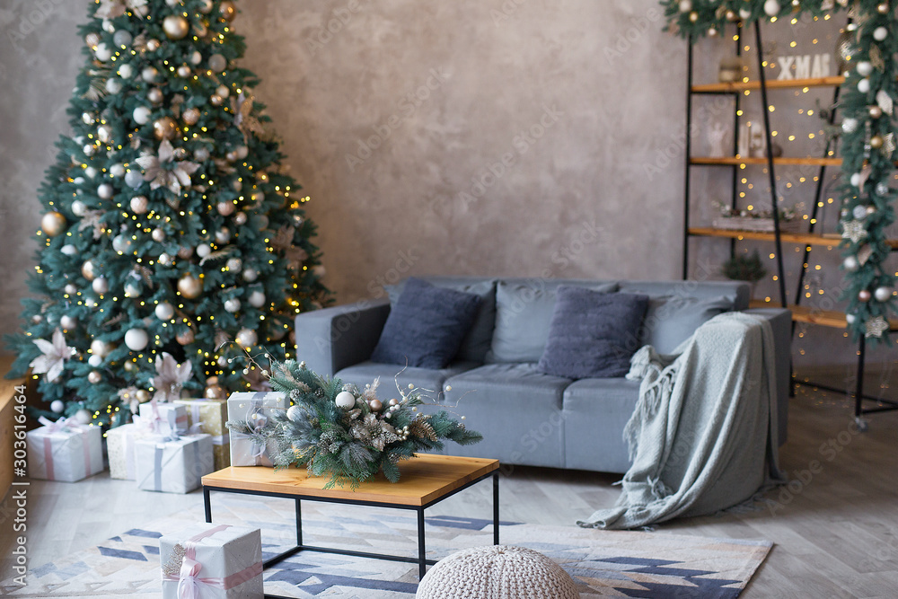 Fototapety, obrazy: Interior of modern living room with comfortable sofa decorated with Christmas tree and gifts