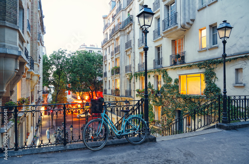 Bike and staircase in Montmartre, Paris - 303616441