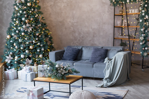 Fotografija  Interior of modern living room with comfortable sofa decorated with Christmas tr