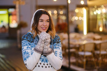 Young Attractive Woman In Winter Jumper Feels Happy On Christmas Eve.