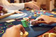 People play casino poker at a table in a casino.