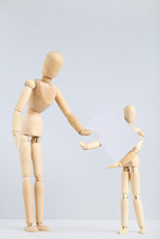 Two Wooden Figures Holding Bla...