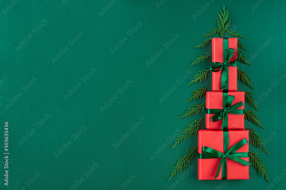 Fototapety, obrazy:  Red gift boxes in the form of christmas tree . Christmas card. Flat lay. Top view with copy space
