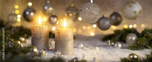 Creative Advent decoration with two burning candles (part of a set)