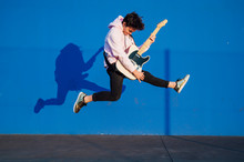 Young Man Jumping With Electri...