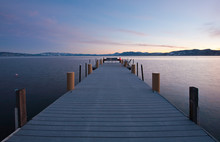 A Pier Out In A Lake At Sunset