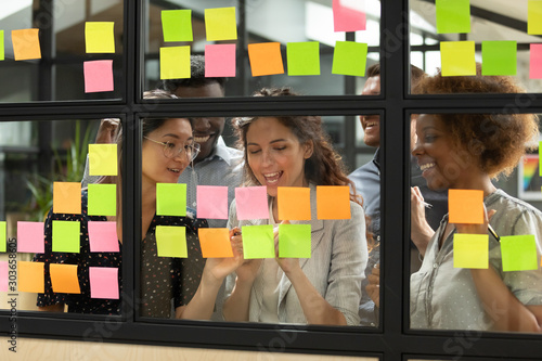 Photo Diverse teammates satisfied with working process at office.