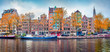 Panoramic autumn view of Amsterdam city. Famous Dutch channels and great cityscape. Splendid morning scene of Netherlands, Europe. Traveling concept background.