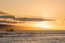 Sail Boats At Sunset On The Ocean