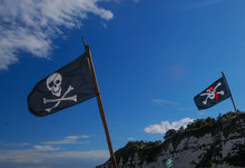 Pirate Flag In Front Of Blue Sky