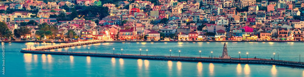 Fototapeta Panoramic morning cityscape of Argostolion town, former municipality on the island of Kefalonia, Ionian Islands, Greece. Impressive summer seascape of Ionian Sea. Traveling concept background.