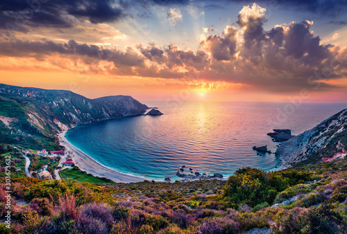 Unbelievable summer view of Petani Beach. Majestic sunset on Cephalonia Island, Greece, Europe. Beautiful evening seascape of Mediterranen Sea. Fantastic outdoor scene of Ionian Islands.