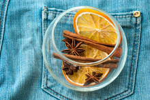 Composition From Spices: Dried Orange, Anise, Cinnamon. On Jeans Background