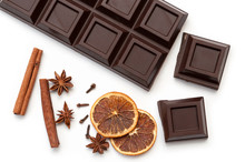 Dark Chocolate, Dried Orange, Anise, Cinnamon, Cloves - Composition. View From Above. Isolated On White Background.