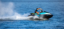 A Man On Jet Ski With Much Splashes. Water Sports. Vacation Concept.