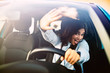 Afraid young woman screaming in the car. Scared driver driving a car before an accident. Woman being scared and surprised while driving the car.