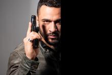 Portrait Of A Man Holding Gun....