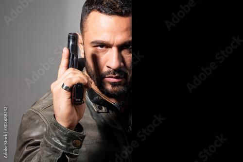 Fototapeta  Portrait of a man holding gun