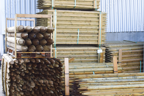 Slika na platnu Wooden stakes. Building materials in stock.