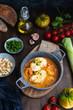 Mediterranean catalan cuisine ingredients, shrimps, raw monkfish, tomatoes, garlic, almonds, olive oil top view