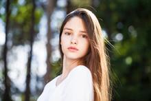 Close Up Brunette Girl In Summer Park Background