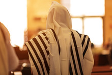 Orthodox Ultra Orthodox Jew From A Tallit In The Synagogue. Rear View Of An Orthodox Jew In The Mantle, A Bit In The Synagogue
