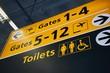 Leinwandbild Motiv Toilets and gate signs in an airport terminal