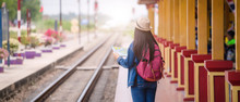 Young Asian Gril Walking At Train Station Before Travel. Work And Travel Concept.