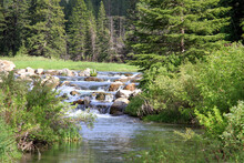 Stream Cascades Over Rocks In Spearfish Canyon