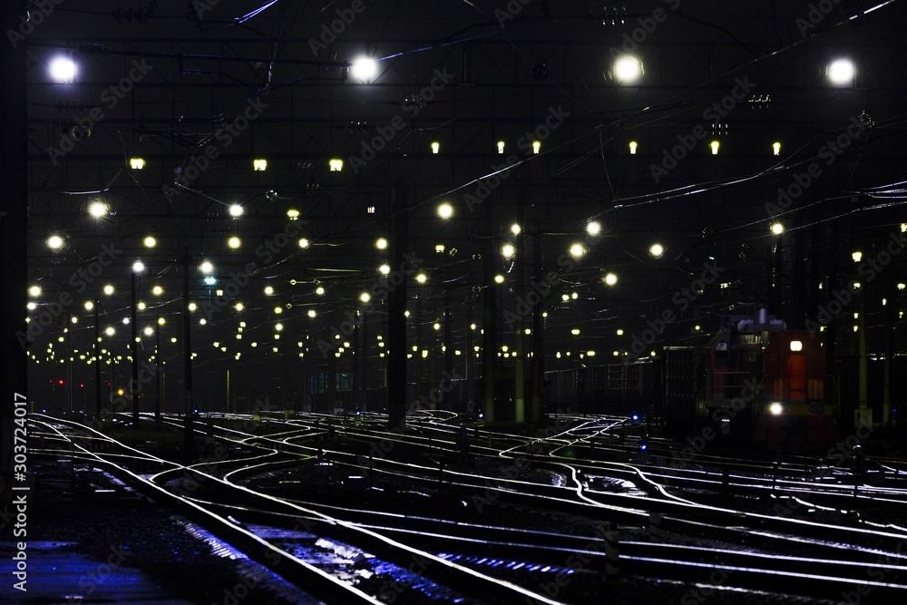Fototapety, obrazy: Beautiful shot of an illuminated railway station at night