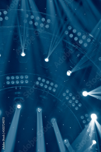 Stage lighting effect in the dark, close-up pictures - 303724070