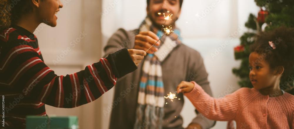 Fototapety, obrazy: family celebrating with sparkler fireworks .Christmas Celebration tradition concept.