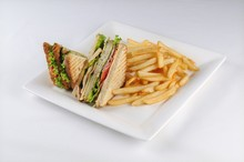 Isolated Shot Of A Club Sandwich And French Fries -  Perfect For A Food Blog Or Menu Usage