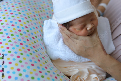 mother parenting, mom using hand help a baby newborn belch burping after breastf Tablou Canvas