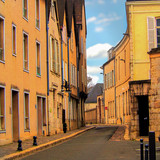 Fototapeta Uliczki - orange buildings and empty street