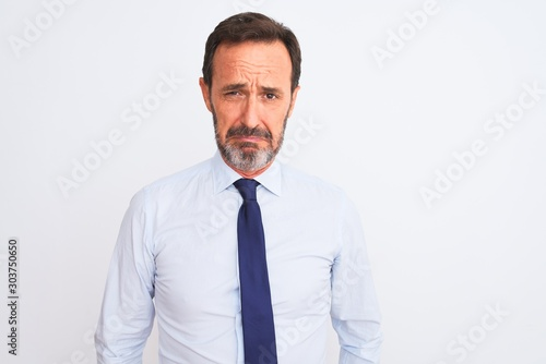 Fototapety, obrazy: Middle age businessman wearing elegant tie standing over isolated white background depressed and worry for distress, crying angry and afraid. Sad expression.